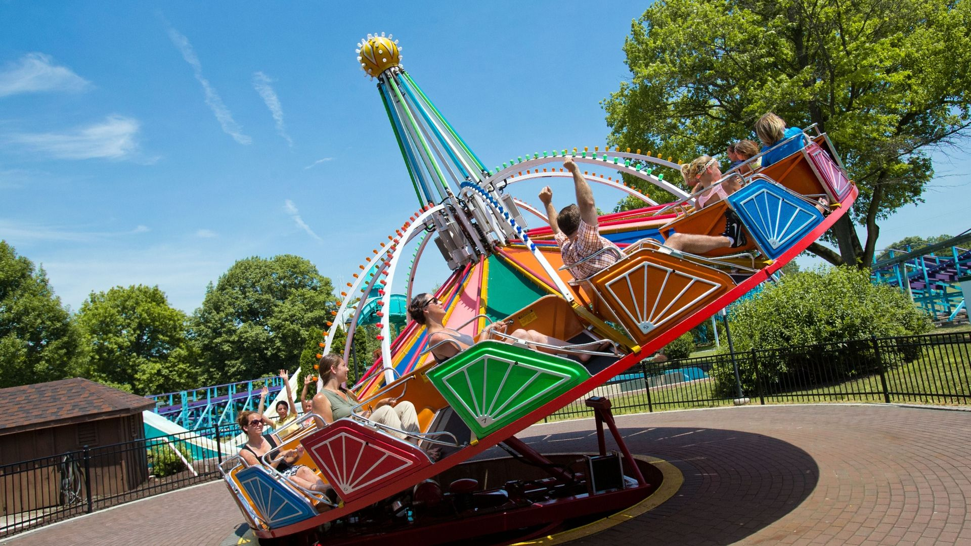 Families riding in colorful undulating twister ride