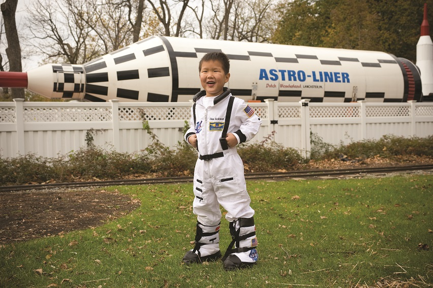 Boy wearing astronaut costume at Dutch Wonderland