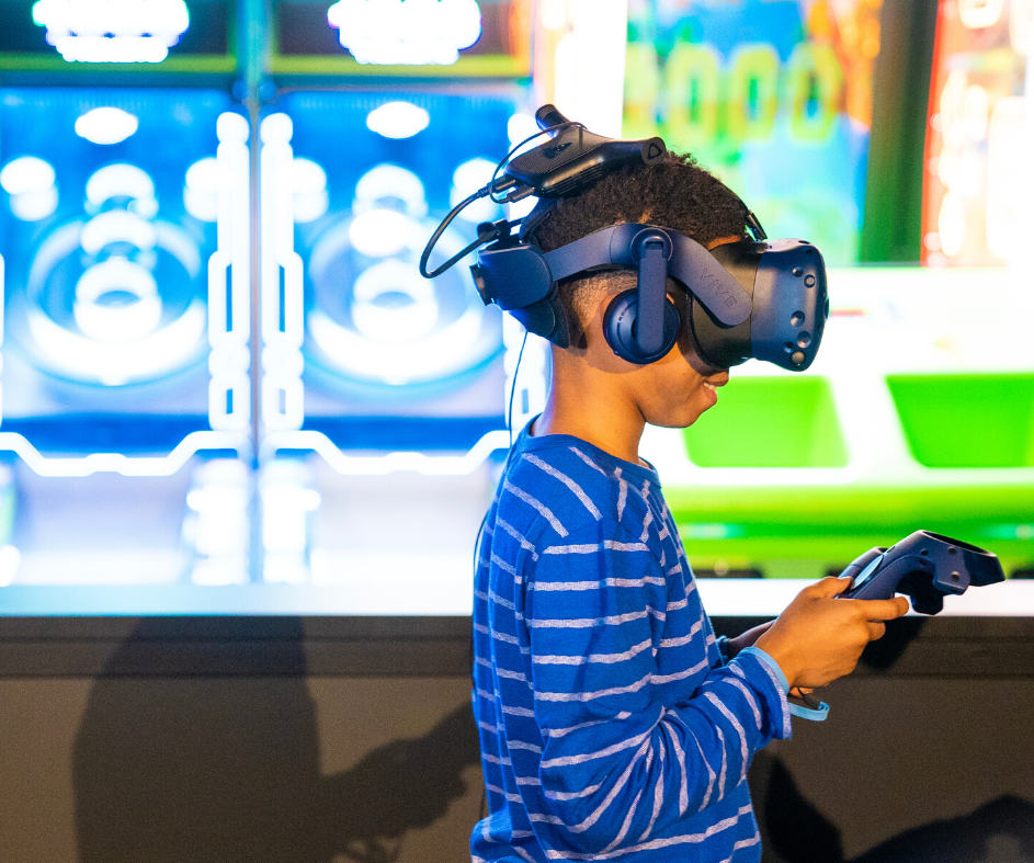 Boy playing a VR headset game