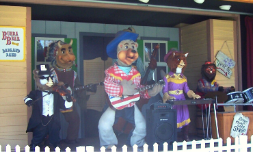 Animal animatronics playing instruments on a stage