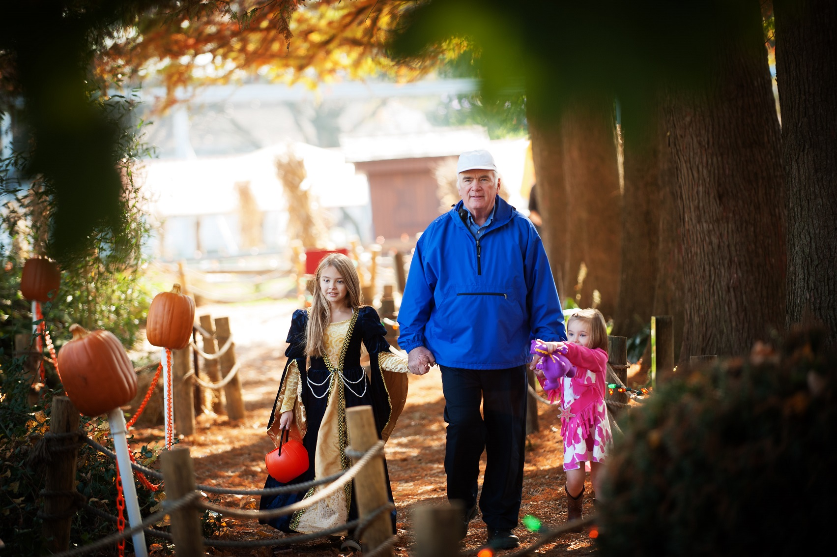 Girl and grandfather walking down trail