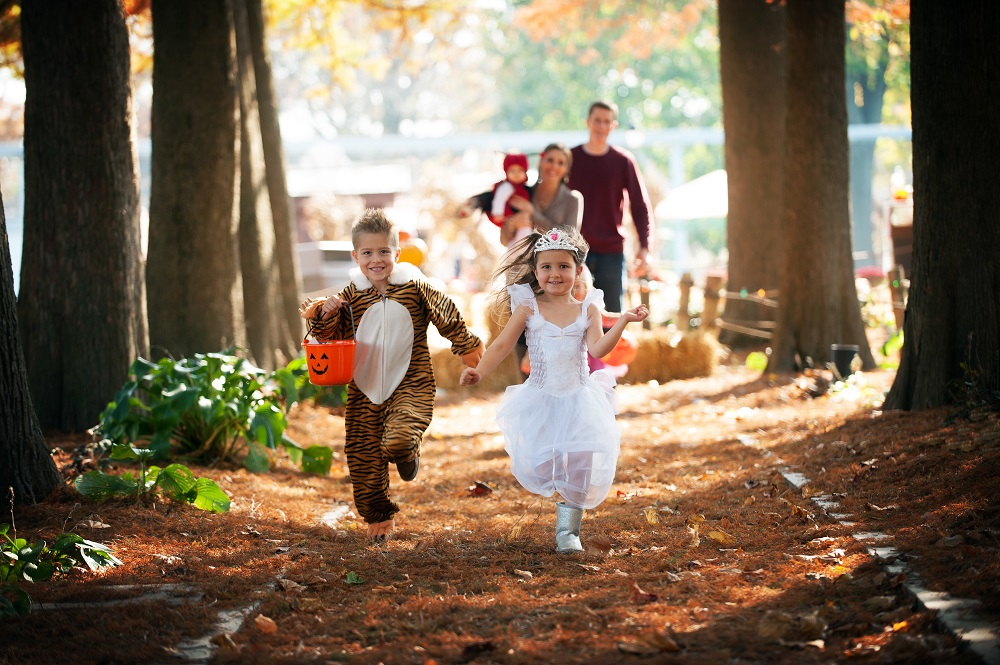 Children running down trick or treat trail