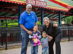 Grandparents with grand children in front of train station