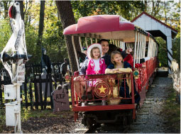 Family riding on a train during Happy Hauntings