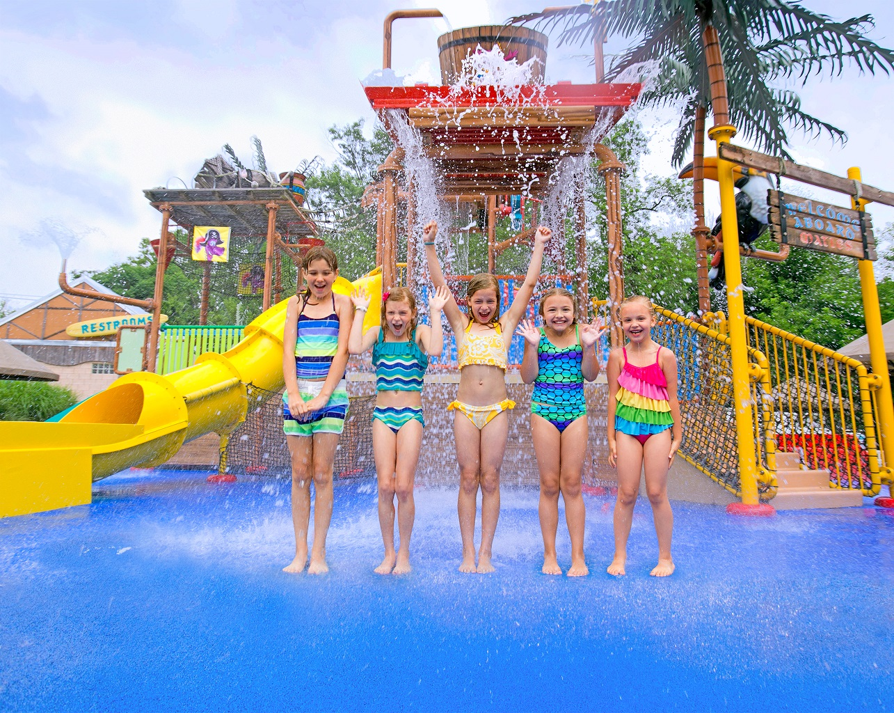 Five girls in water play area