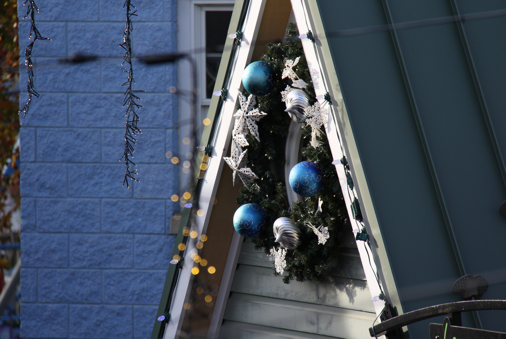 Holiday wreath on ticket booth turret