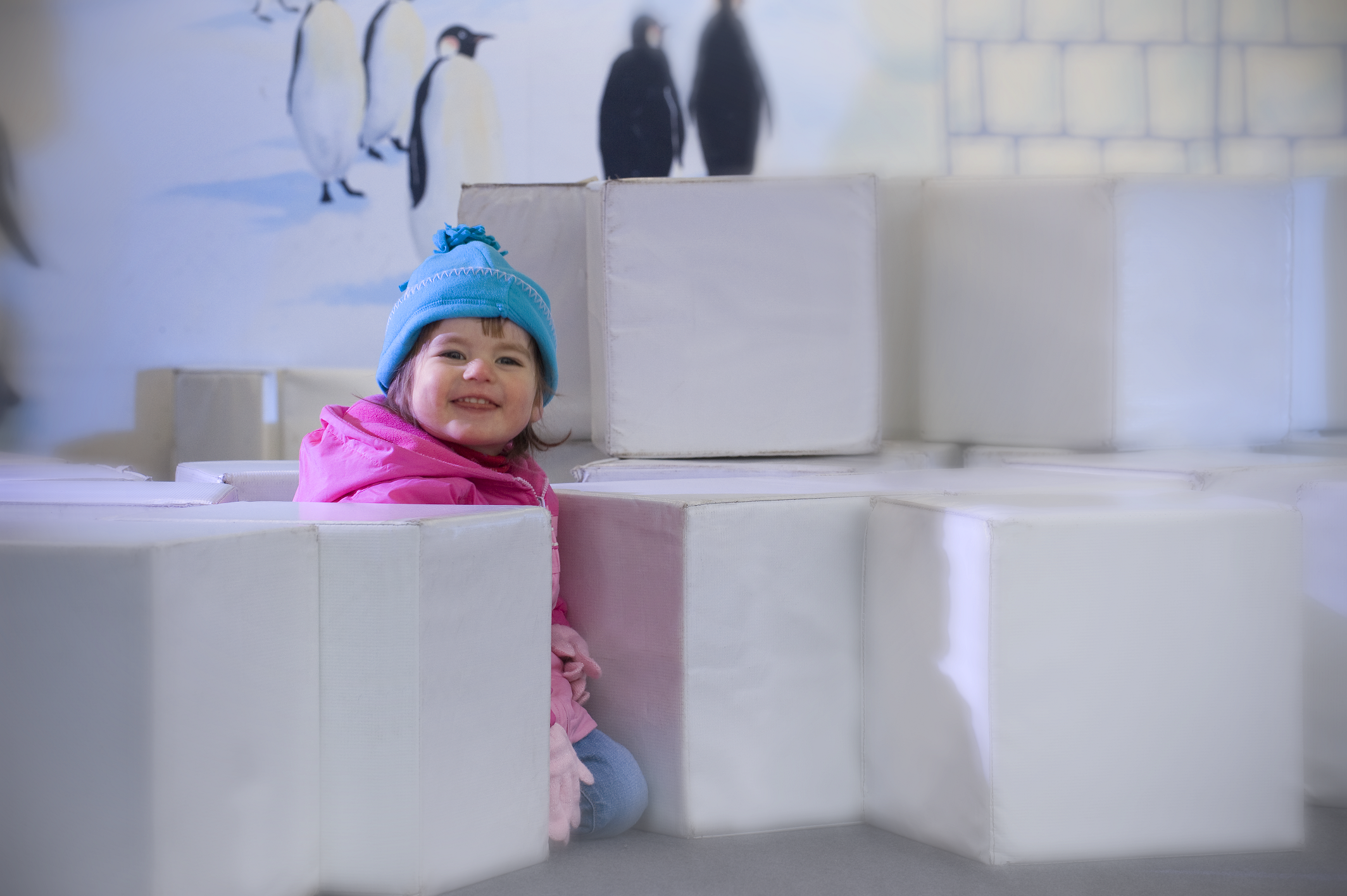 girl playing with blocks in play area