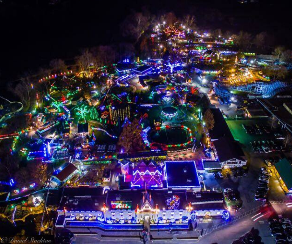 Arial shot of Dutch Wonderland at night with holiday lights