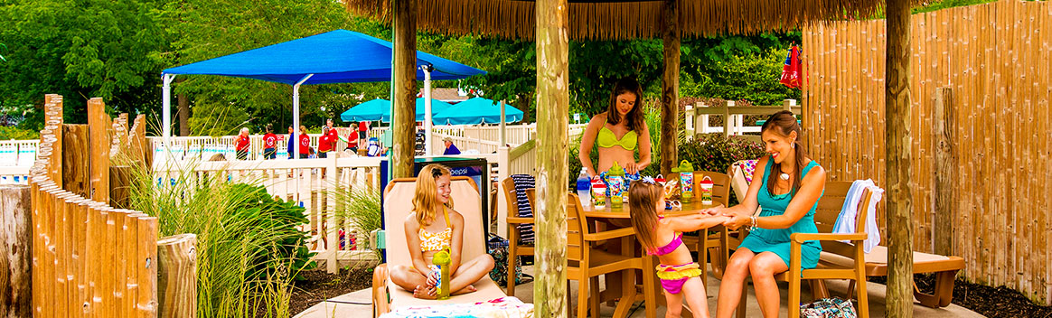 Family seated in large cabana area
