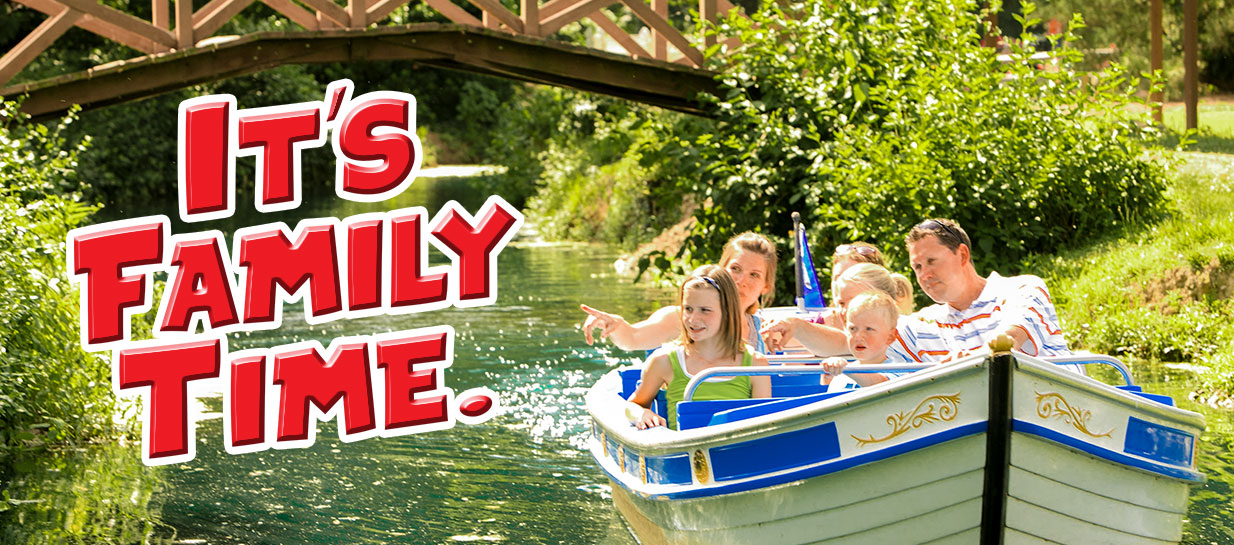 Family enjoying scenery in a boat on a river