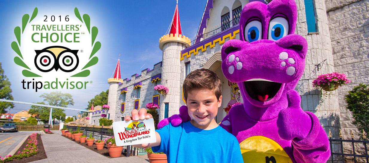 Boy with purple dinosaur in front of castle