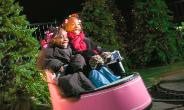 Two children in spinning ride