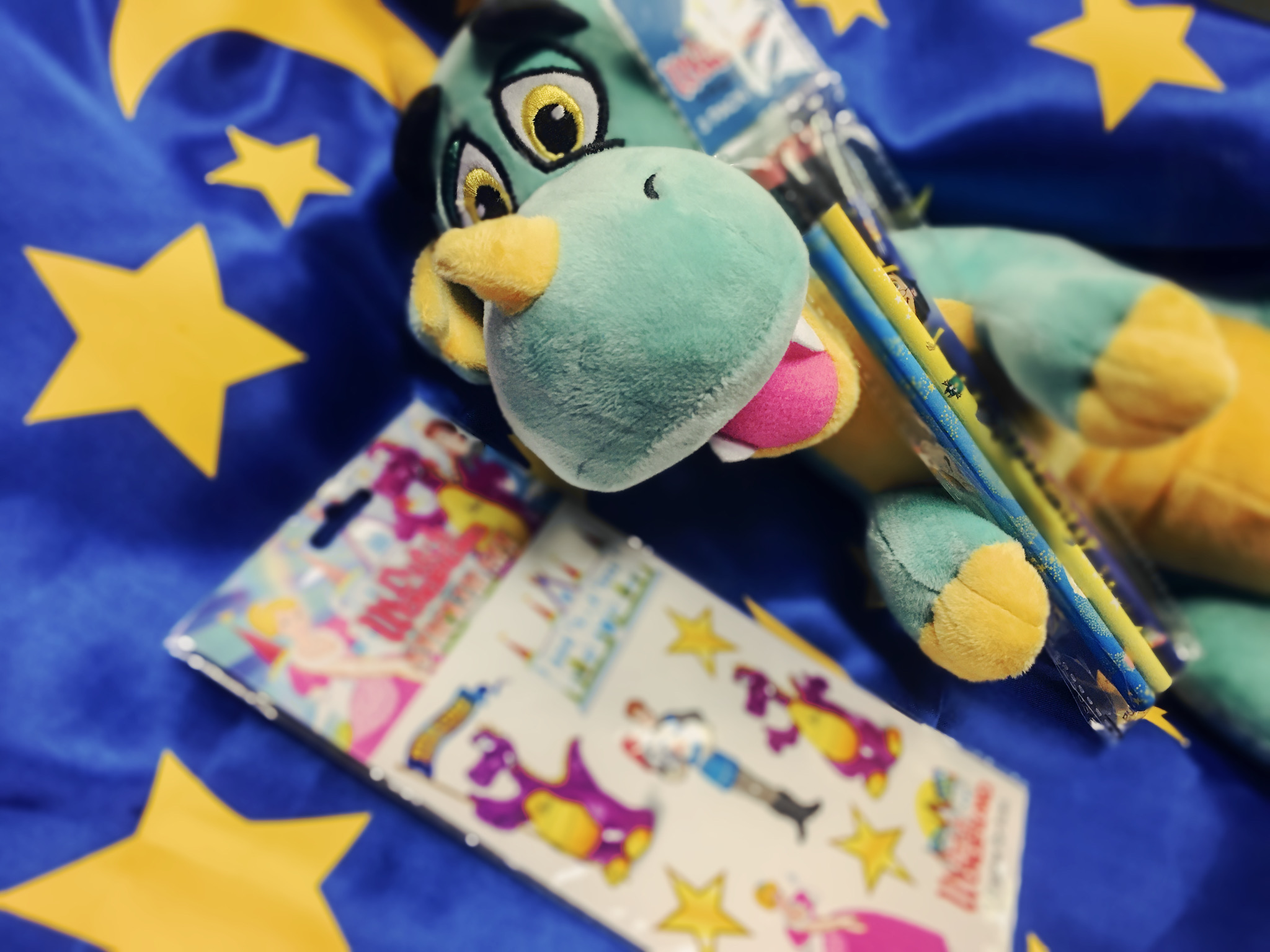 Mayhem the dragon plush toy with pencils, book and cape