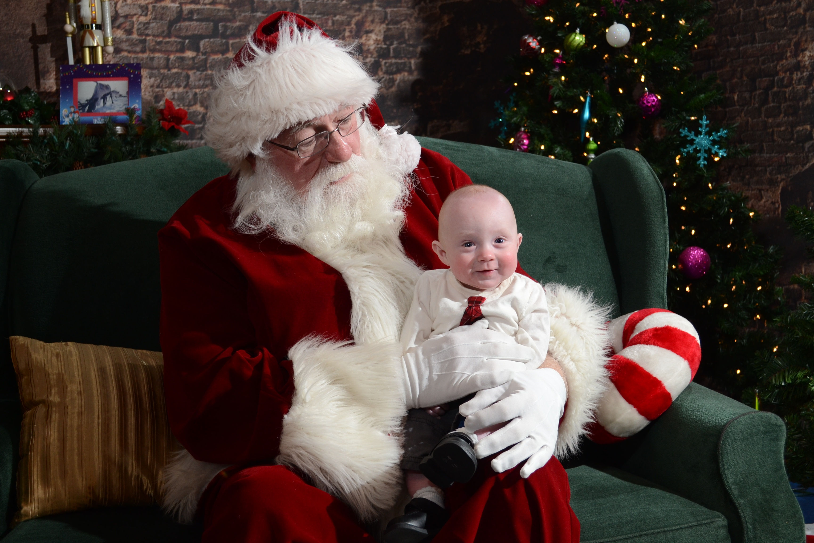 Santa holding baby on his lap