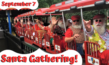 Train cars filled with summer dressed Santas, waving at guests